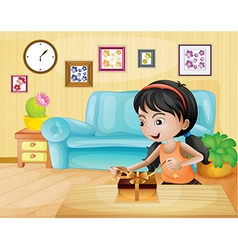 A lady opening her gift in the living room vector