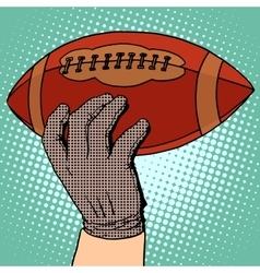 The ball of american football in his hand vector