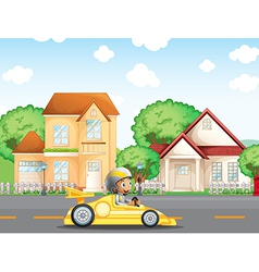 A boy in his racing car across the neighborhood vector