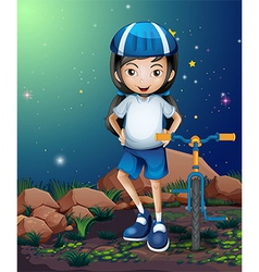 A female biker standing near the rocks vector