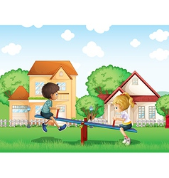 Kids playing at the park in the village vector image