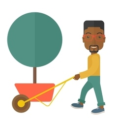 Young african man pushing the cart with tree vector