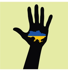 Hand with Ukraine map with the flag inside vector image