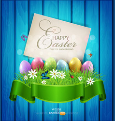 Easter eggs with greeting card grass and flowers vector