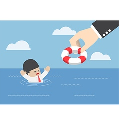 Drowning businessman getting lifebuoy from hand vector