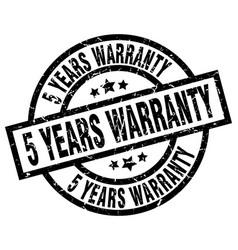 5 years warranty round grunge black stamp vector image vector image