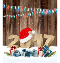 Christmas background with a 2017 and a gift boxes vector