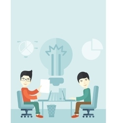 Two japanese businessmen sitting working together vector