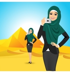Woman taking a picture in egypt vector