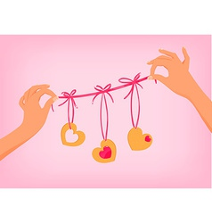 Hands holding cute valentines day garland with vector
