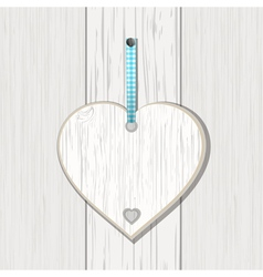 Wooden heart sign on white wood vector