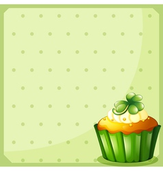 A stationery with a green cupcake vector