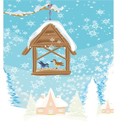 Birdfeeder in winter vector image