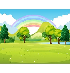 Nature scene of a park with rainbow vector