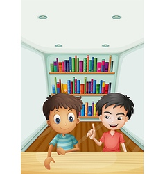Two boys in front of the bookshelves with books vector image vector image
