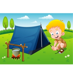 Boy scout in camp vector image