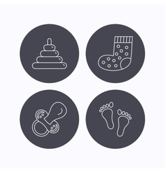 Footprint pacifier and socks icons vector