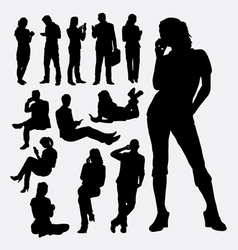 Male and female people with mobile phone silhouett vector