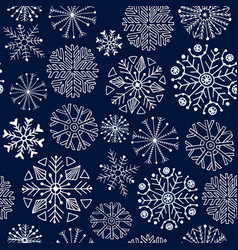 Snowflakes seamless pattern on dark background vector