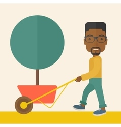 Young african man pushing the cart with tree vector image