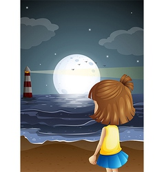 A small girl at the beach watching the lighthouse vector