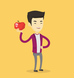 young man holding apple vector image vector image