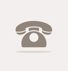 Classic phone icon with shadow on a beige vector