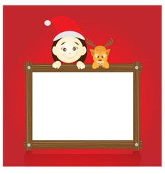Santa claus and reindeer holding wood board vector image