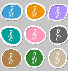 Treble clef icon multicolored paper stickers vector