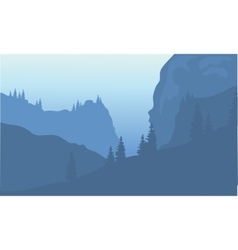 Silhouette of cliff and forest vector