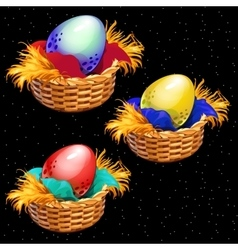 Three colored eggs closeup in straw baskets vector