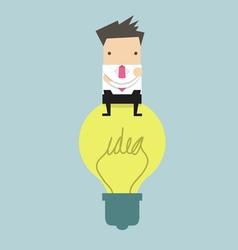Businessman sitting on idea bulb vector
