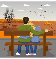 young couple sitting together on bench outdoors vector image vector image
