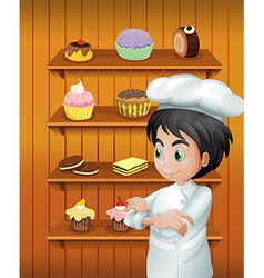 A chef in front of the baked goodies vector
