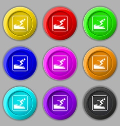 Skier icon sign symbol on nine round colourful vector