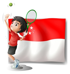 A boy playing tennis in front of the flag of vector image vector image