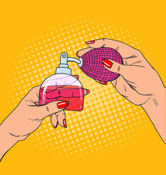 Pop art woman hands with bottle of luxury perfume vector