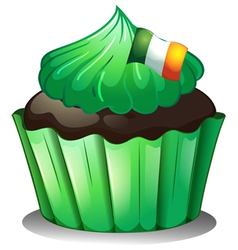 A green cupcake with the flag of ireland vector