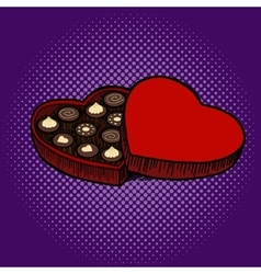 Heart shaped box with chocolate candies pop art vector