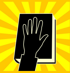 The hand on the book vector