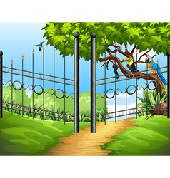 Scene with metal fence and birds on tree vector