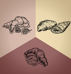 Three different hand drawn croissants vector