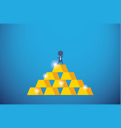 Businessman on top of gold bars success vector