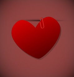 Heart shape paper with paperclip vector