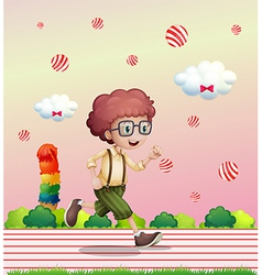 A curly boy running vector image vector image