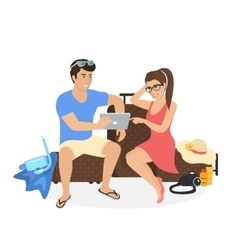 Young couple sitting on the luggage and using vector