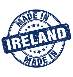 made in ireland blue grunge round stamp vector image vector image