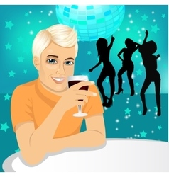 Handsome man drinking wine vector