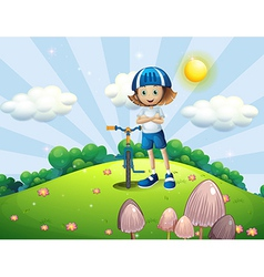 A hilltop with a female biker wearing a helmet vector