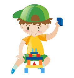 happy boy playing with blocks vector image